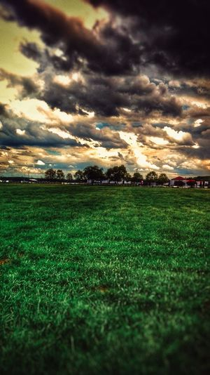 Grass Field Dramatic Sky Cloud - Sky Agriculture Sunset Nature Beauty In Nature No People Sky Outdoors Landscape Rural Scene Night Soccer Field HDR Storm Grass Sun Cloud Nature Dramatic Sky Agriculture