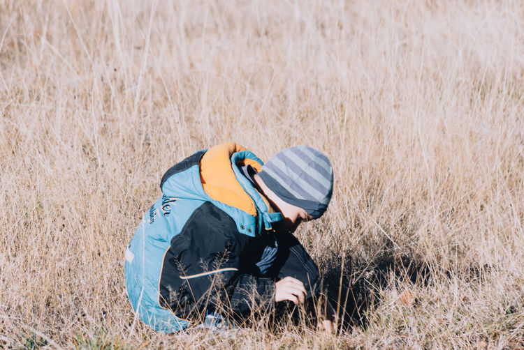 Cute boy playing on grassy field