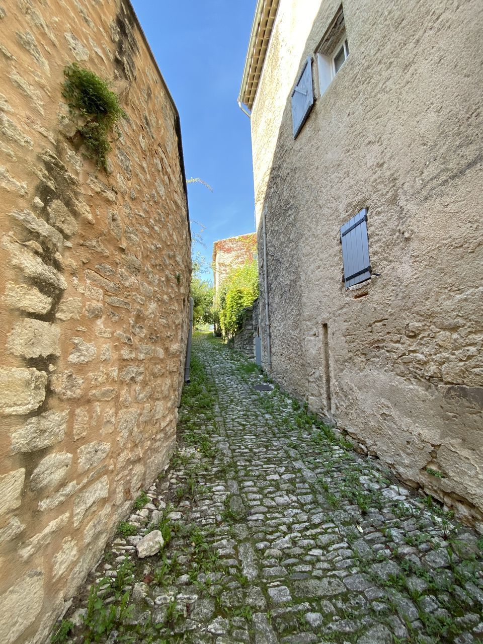 built structure, architecture, building exterior, wall, wall - building feature, day, no people, stone wall, building, the way forward, sky, nature, footpath, old, direction, street, cobblestone, outdoors, alley, plant