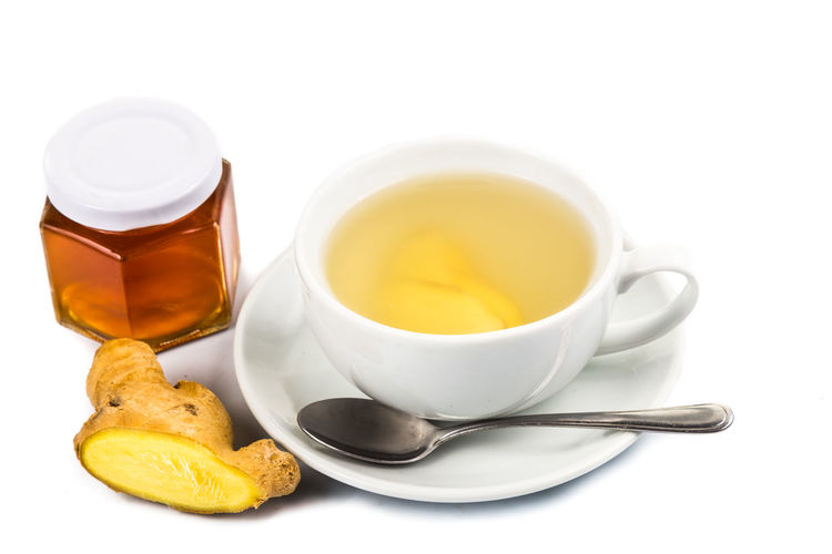 Refreshing and healthy ginger with raw organic honey drinks Ginger Tea Tea Close-up Cup Drink Food Food And Drink Freshness Ginger Honey Hot Drink Indoors  No People Refreshing Refreshment Still Life Studio Shot Tea Tea - Hot Drink White Background