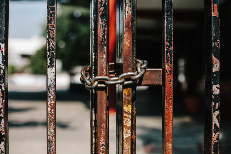 Close-up of chain on metallic gate