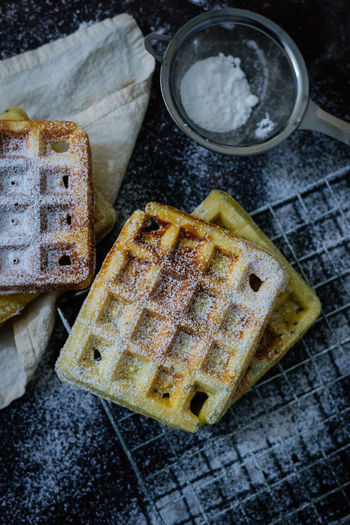 Icicles Waffle Baked Baked Pastry Item Breakfast Brown Bread Close-up Day Food Food And Drink Freshness Healthy Eating Indoors  Loaf Of Bread No People Powdered Sugar Preparing Food Ready-to-eat SLICE Snack Tea Strainer