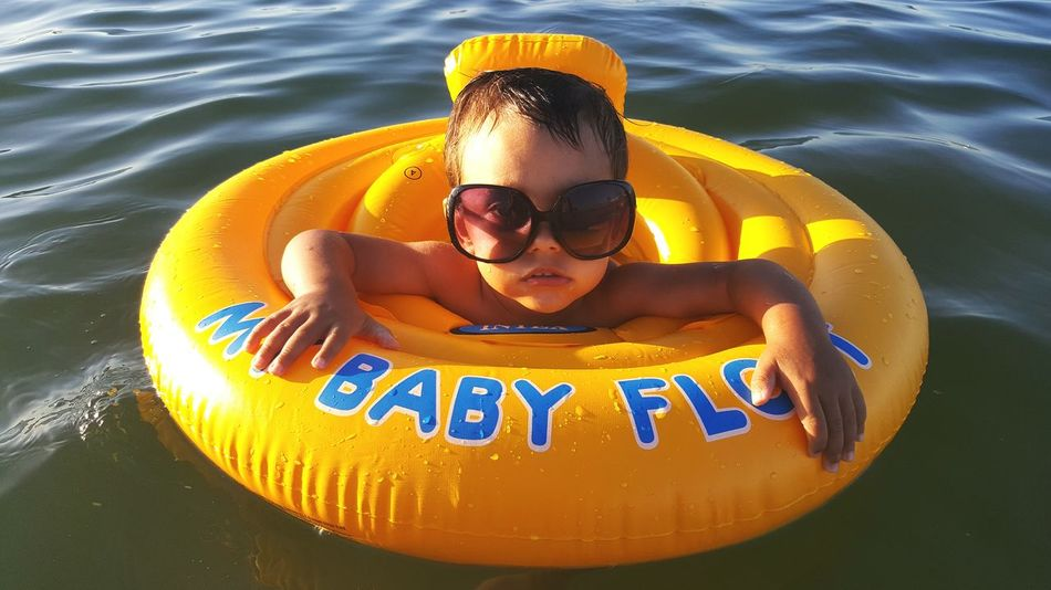 Float Floating On Water Summer Baby Babyboy Relaxing Enjoying The Sun Enjoying The View Glasses Nifty Cute Beach Sea Heat Refreshing :) Refresh Mobilephotography Buoy Uniqueness