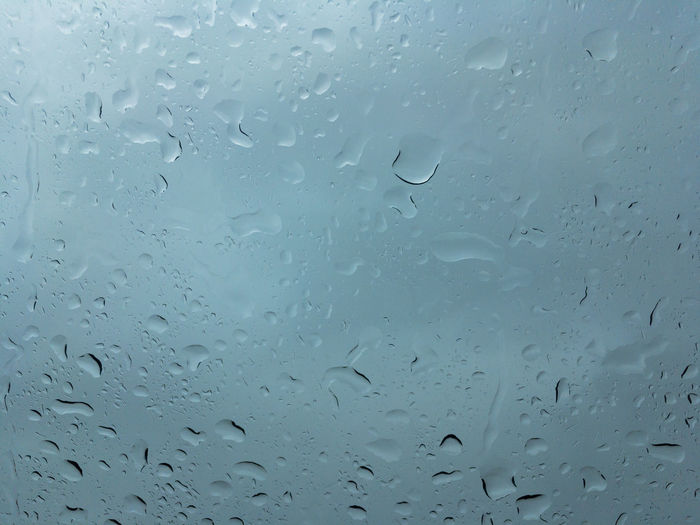 Huge drops of rain on glass, rain drops on clear glass roof of a car Drop Full Frame Water Window Wet Backgrounds Glass - Material Transparent Rain No People Indoors  Close-up Nature RainDrop Day Rainy Season Low Angle View Glass Purity Car