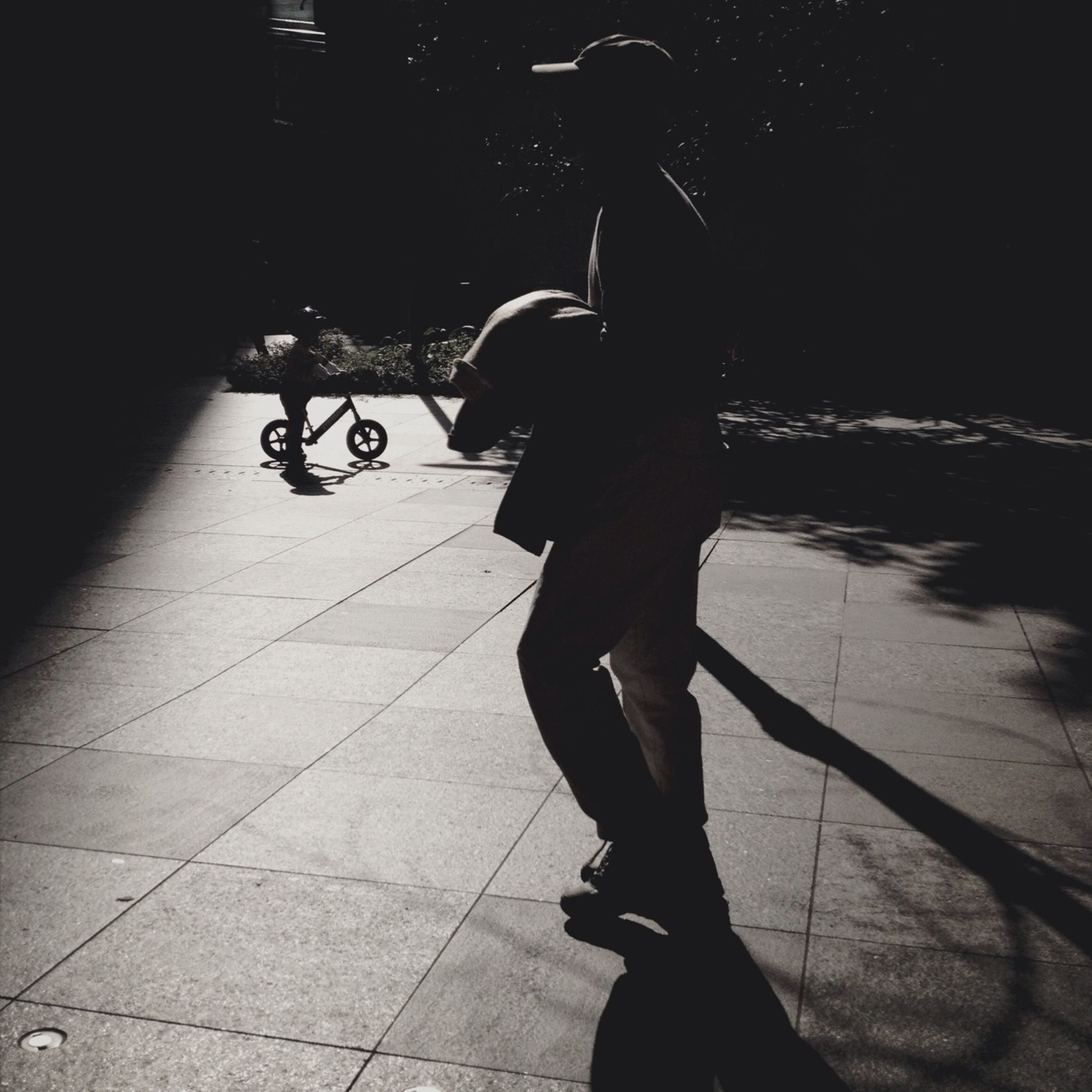 full length, lifestyles, leisure activity, shadow, street, men, walking, bicycle, rear view, transportation, sunlight, casual clothing, silhouette, boys, city life, on the move, outdoors