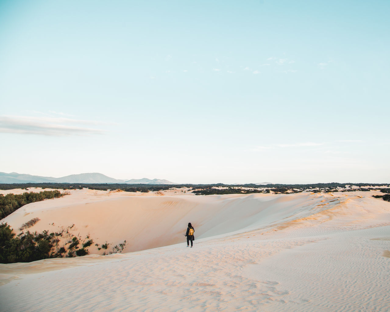 Woman Walking On Sand Against Sky