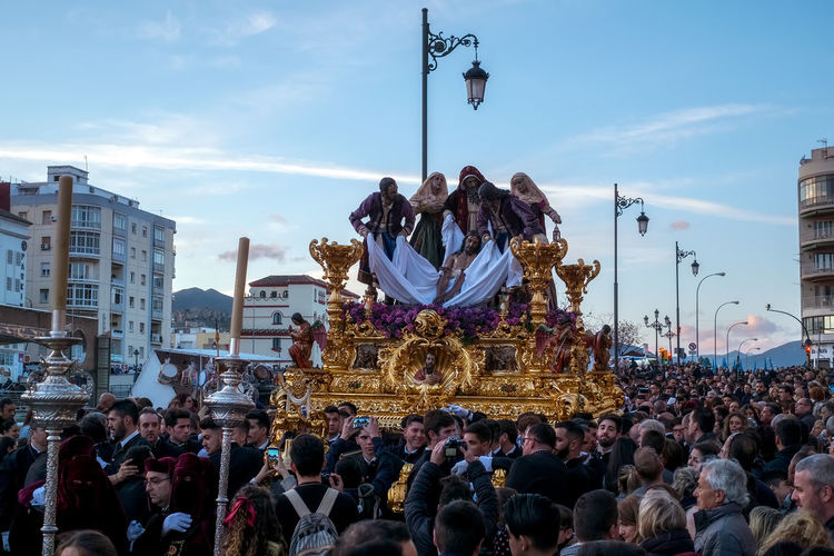 Catholic religious procession in the Holy Week in a Spanish city Holy Week Semana Santa Adult Architecture Building Exterior Built Structure Catholic Church Catholicism Celebration City Cloud - Sky Crowd Group Of People Holydays Large Group Of People Leisure Activity Lifestyles Men Nature Real People Representation Sky Spain Is Different Spanish Arquitecture Spanish Culture Street Women The Street Photographer - 2018 EyeEm Awards