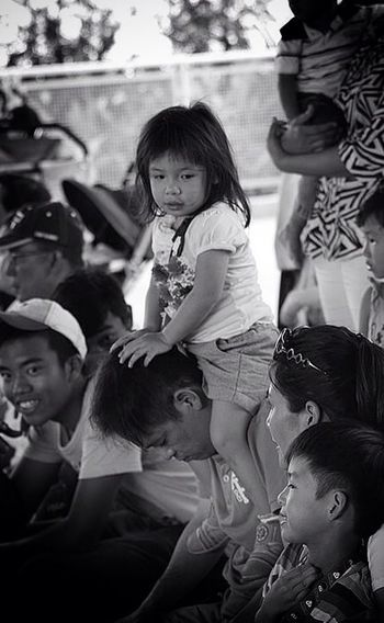 Girl, you can sit on daddy's shoulders but daddy needs to take a nap too. Happiness Streetphoto_bw B+W People Watching