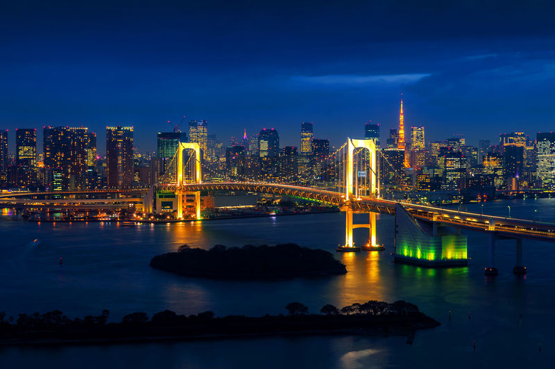 Tokyo skyline with Rainbow bridge and Tokyo tower. Tokyo, Japan. Architecture Blue Bridge - Man Made Structure Building Exterior Built Structure City Cityscape Connection Illuminated Modern Night No People Outdoors Sky Skyscraper Suspension Bridge Transportation Travel Destinations Urban Skyline Water Waterfront