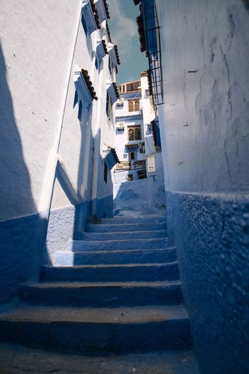 High angle view of steps amidst buildings