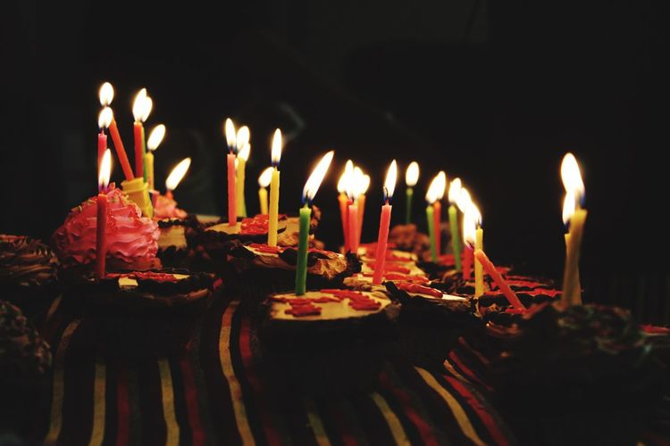 Illuminated Candles In Cupcake On Table