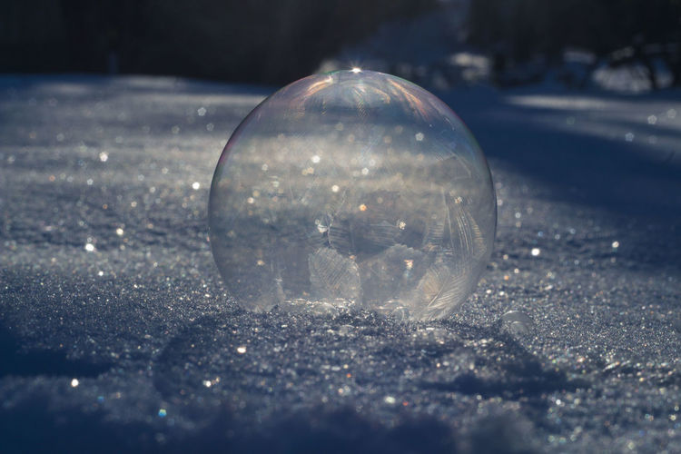 Close-up of glass ball on snow
