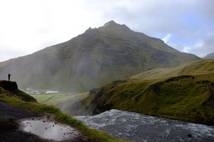 Landscape Hiking Nature Mountain Travel Waterfall Tourist Attraction  Taking Photos On The Edge One Man Precipice River Mist Skogafoss Iceland Vastness Betterlandscapes Lost In The Landscape Be Brave