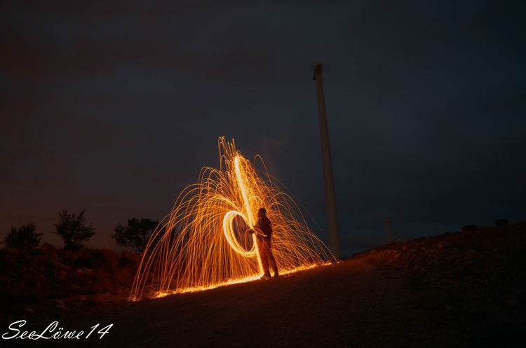 Night Orange Color Illuminated Long Exposure Sky Outdoors Molino De Viento Fire Arts Culture And Entertainment Motion Light Trail