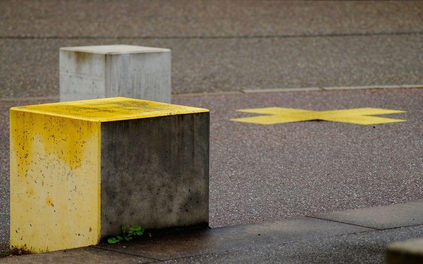 Close-up of yellow arrow symbol