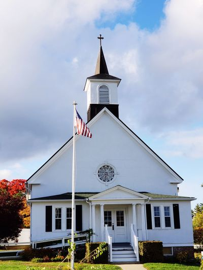 Church Patriotism Flag History Cultures Sky Architecture Building Exterior Grass