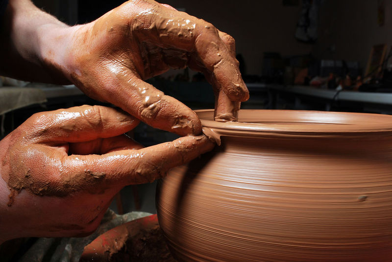 Potter hands making in clay on pottery wheel. Art Artisan At Work Ceramic Clay Craftsman Handicraft Handmade Hands Industrial Makeup Making Master People Pot Potter Wasp Pottery Pottery Passion Pottery Talavera Profession Wheel Wheels Work Workshop EyeEm X Lexus - Your Design Story Your Design Story Winners 🎁
