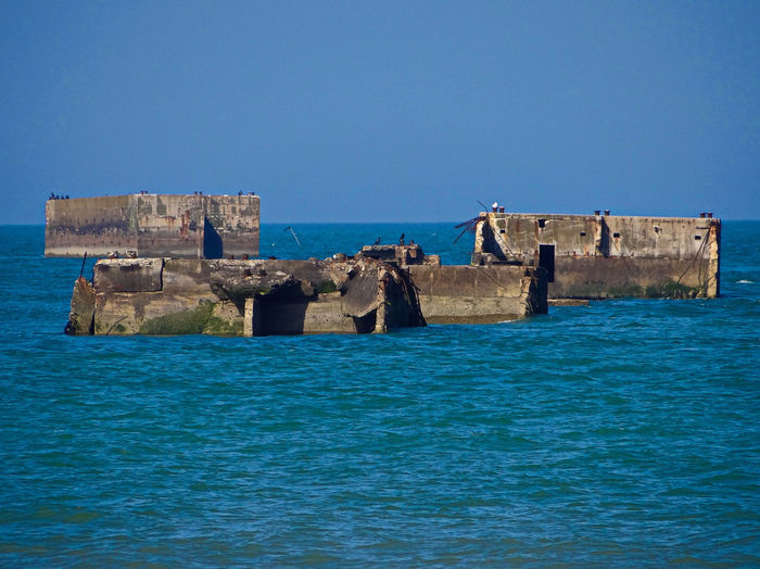 The remains of the Mulberry harbour from the shoreline of Gold Beach... Gold Beach Mulberry Harbour Normandy Beach Normandy Beaches Normandy, France Phoenix Caissons WWII WWII History