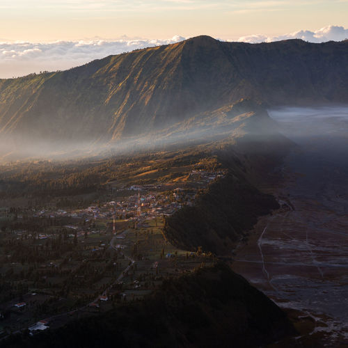 Some clouds cross the village of mount bromo