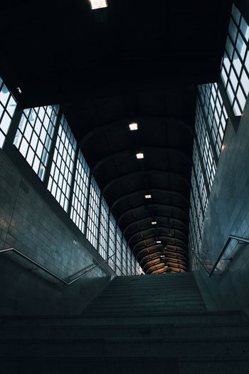 Low angle view of illuminated staircase at railroad station