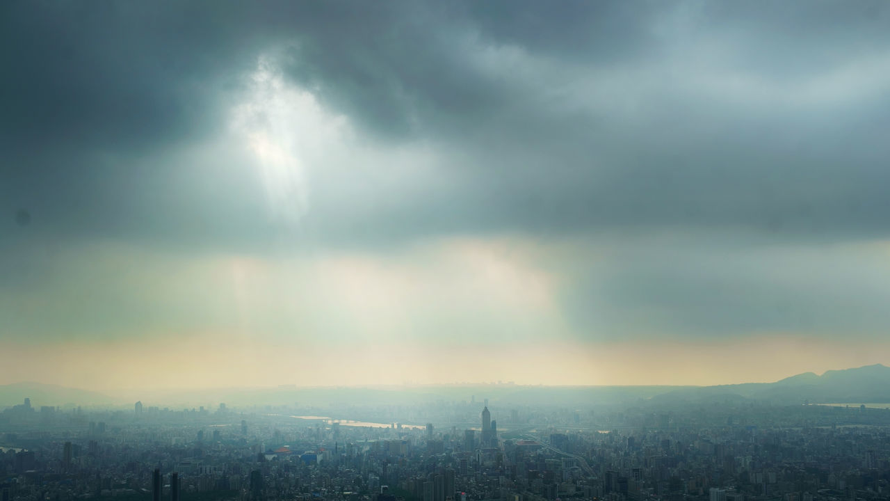 cityscape, city, cloud - sky, architecture, crowded, sky, building exterior, built structure, skyscraper, day, outdoors, modern, travel destinations, storm cloud, nature, beauty in nature