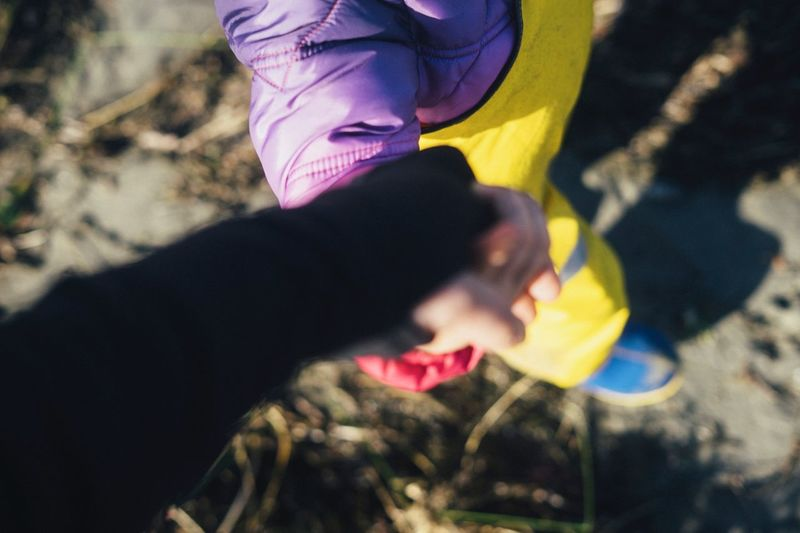 Holding hands Parenthood Safe Walk Friends Childhood Holding Hands Lifestyles Women Real People Leisure Activity Two People Adult People Focus On Foreground Human Body Part Close-up Human Hand Yellow Hand Moments Of Happiness