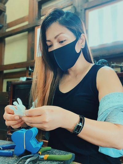 Portrait of beautiful woman holding camera