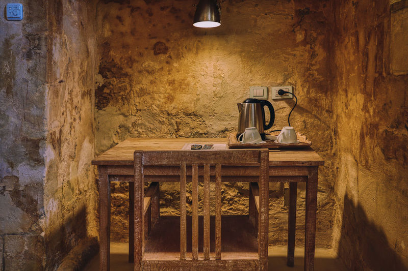 Matera 2018 Indoors  No People Wood - Material Architecture Wall - Building Feature Old Table Built Structure Lighting Equipment Illuminated Seat Building Chair History The Past Day Wall Light Electric Lamp