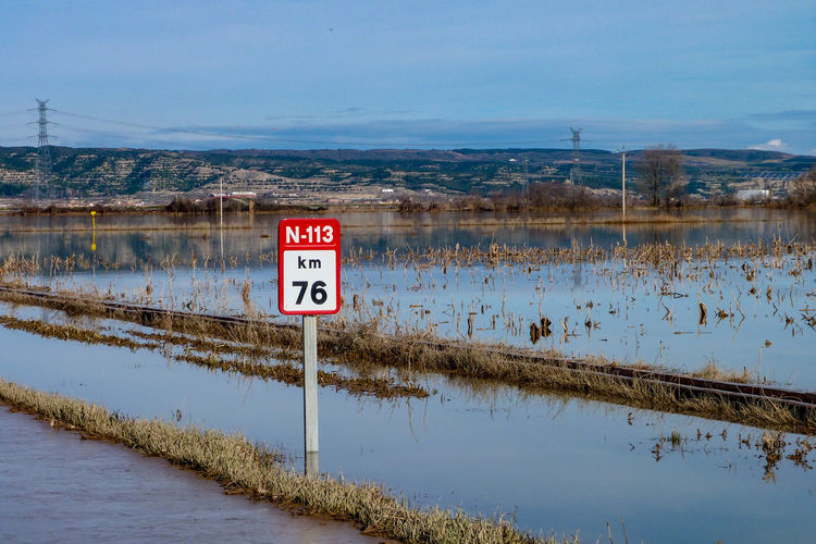 Water road Farmland Distance Winter Rainy Days Road Road Sign Country Road Town Village SPAIN Travel Traveling Roadtrip Sunken Flooding Flooded Water Road Sign Road Flood Lake Communication Text Reflection Sky Landscape Road Warning Sign Information Signboard TOWNSCAPE