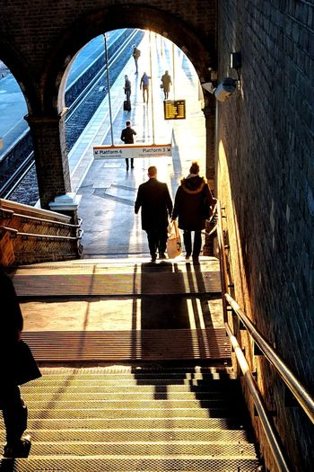 There is just something about the sun... Sun Shadow Men Full Length Women City Walking Shadow Arch Architecture Built Structure Steps And Staircases Staircase Stairway Railing Bannister Hand Rail Steps