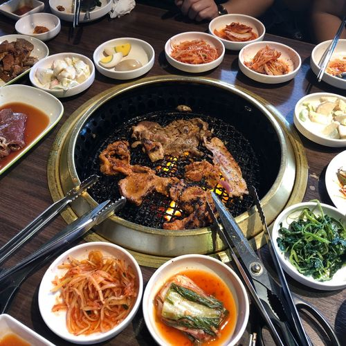 Korean styled barbecue with traditional pickled cabbages and vegetables. EyeEm Selects Food And Drink Food Table Freshness Ready-to-eat Healthy Eating Wellbeing High Angle View Plate Indoors  No People Meat Asian Food Still Life Meal Vegetable Kitchen Utensil