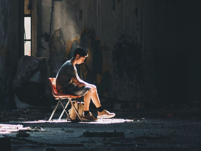 One Person Sitting Real People Full Length Young Adult Men Architecture Day Indoors  Adult People Light And Shadow Abandoned Thinking Chair Building Factory Italy Breathing Space