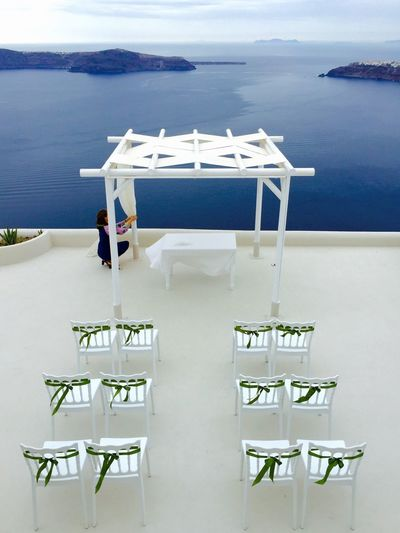 High angle view of empty chairs and tables at beach