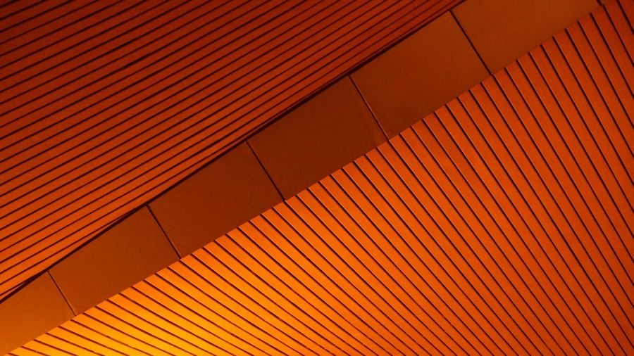 Low angle view of orange ceiling