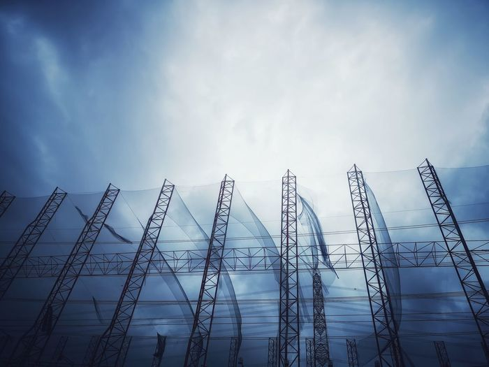 Low angle view of metal structure against sky at construction site