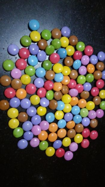 Multi Colored Sweet Food Variation Indulgence No People Temptation Food And Drink Close-up Food Gelatin Dessert Indoors  Freshness Ready-to-eat Chocolate Eating Circle Marbles Eating Gems Colourful Eating Gems Candy Capsule Black Background Temptation Eating Marbles Colourful