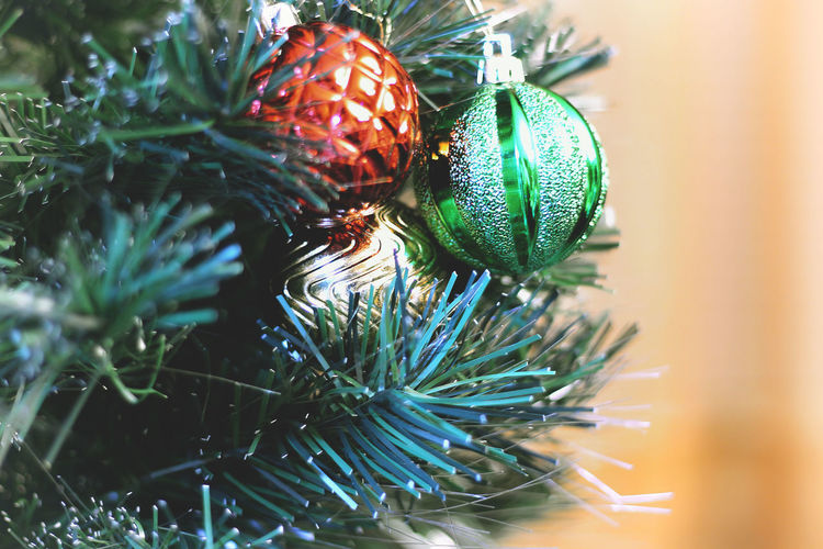 Close-Up Of Christmas Ornaments Hanging On Tree