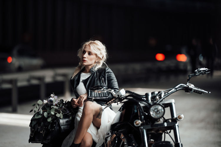 Portrait of woman riding motorcycle in city