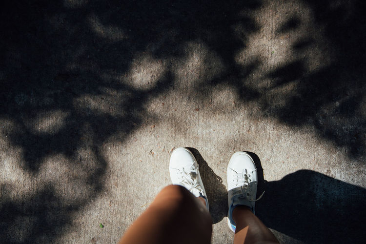 Light Park Life Shadows & Lights Travelling Wandering Wanderlust Body Part Footsteps Forest High Angle View Leaves Lifestyles Nature On The Road One Person Park Personal Perspective Shadow Shadows Shoe Sillouette Sneakers Standing Walking White Shoe A New Beginning