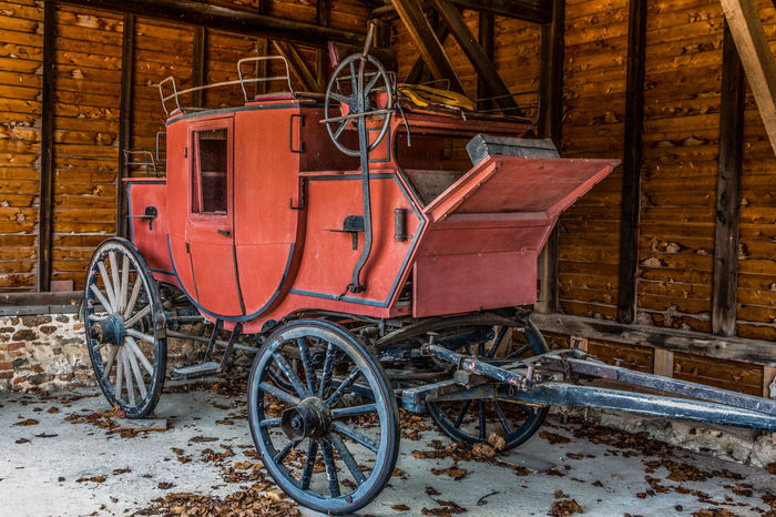 Old Red Stagecoach in a barn 1800s Antique Barn Horse And Carriage Old West  Red Built Structure Day Horse-drawn Land Vehicle Mode Of Transport No People Outdoors Stagecoach Transportation Vintage Wheel