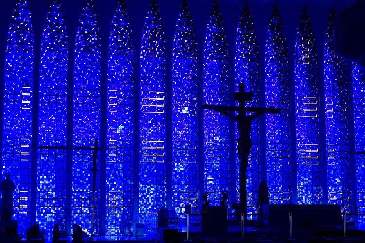 Illuminated building seen through glass window at night