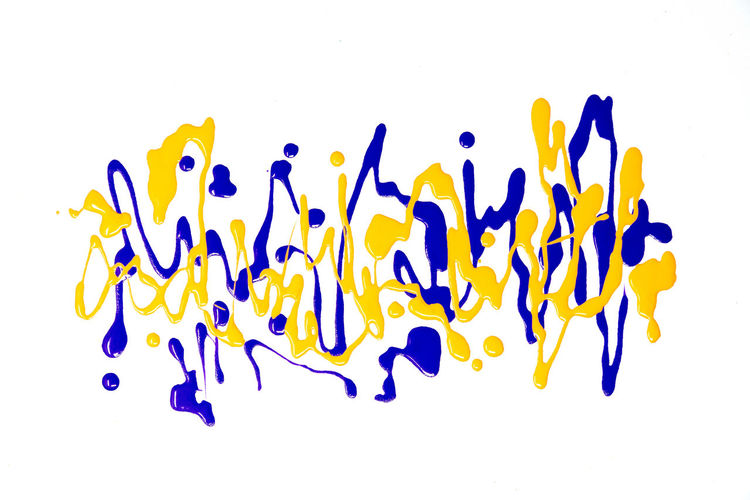 Abstract Textured  Background White Background Studio Shot Indoors  Close-up No People Text Still Life Blue Cut Out Large Group Of Objects Western Script Purple Communication Multi Colored Copy Space Yellow Freshness High Angle View Art And Craft Abundance