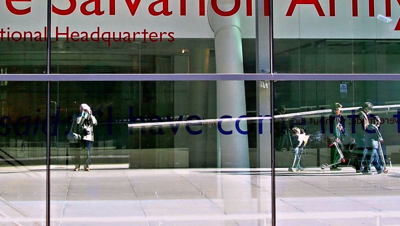 People reflected by a glass facade - Glass - Material Real People Salvation Army Side View Standing