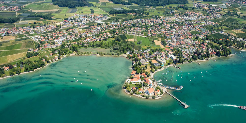 Village Wasserburg at the lake constance with aerial view City Lake Constance Aerial View Architecture Beauty In Nature Building Exterior Built Structure Day Germany High Angle View Lake Landscape Men Nature Nautical Vessel Outdoors People Sea Tree Village Wasserburg Water