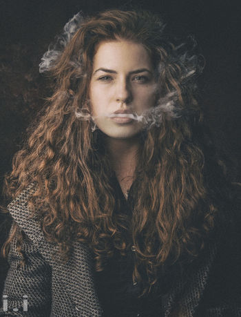 Hairstyle Hair Portrait Young Adult Long Hair Front View One Person Curly Hair Looking At Camera Leisure Activity Young Women Indoors  Beauty Real People Lifestyles Brown Hair Adult Beautiful Woman Teenager Contemplation Wavy Hair Human Hair