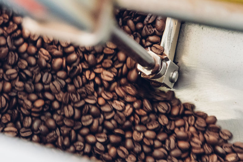 Directly above shot of roasted coffee beans on metal sheet