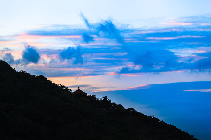 Blue twilight sky above dark silhouette of steep hill and roof of mountain hut in northern Taiwan, near Jiufen Blue Copy Space Travel Twilight ASIA Dramatic Sky Nature Taiwan Cloud - Sky Down Downhill Dusk Forest Landscape Mountain Mountain Range Outdoors Scenics - Nature Silhouette Sky Sunset Tranquil Scene Tree Up Uphill