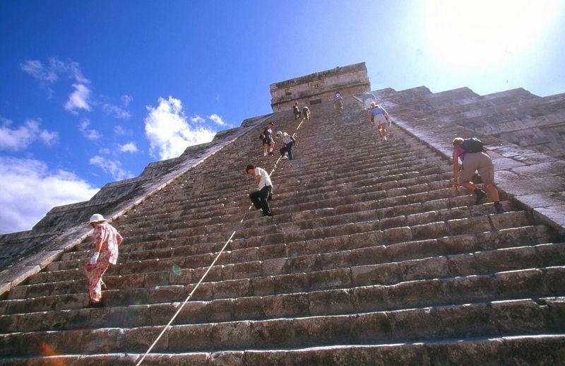 Tourists Climbing Steps Of El Castillo