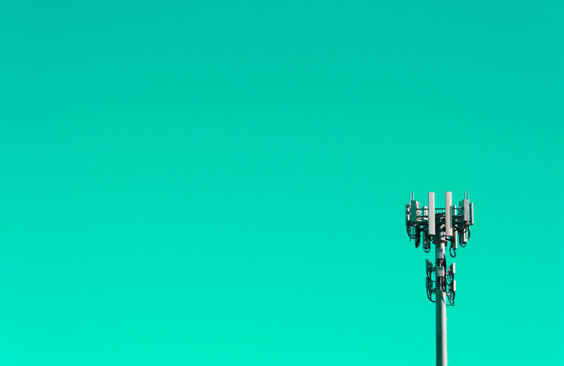 Communications tower against green background