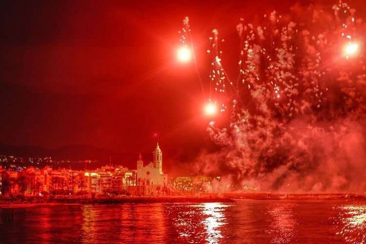 Night Water Illuminated Reflection Red Red Color Fireworks Firework Display Firework - Man Made Object Fireworksphotography Fireworks In The Sky Exploding Exploding Fireworks Sitges España SPAIN Celebration Architecture Sky Outdoors Travel Destinations Red City